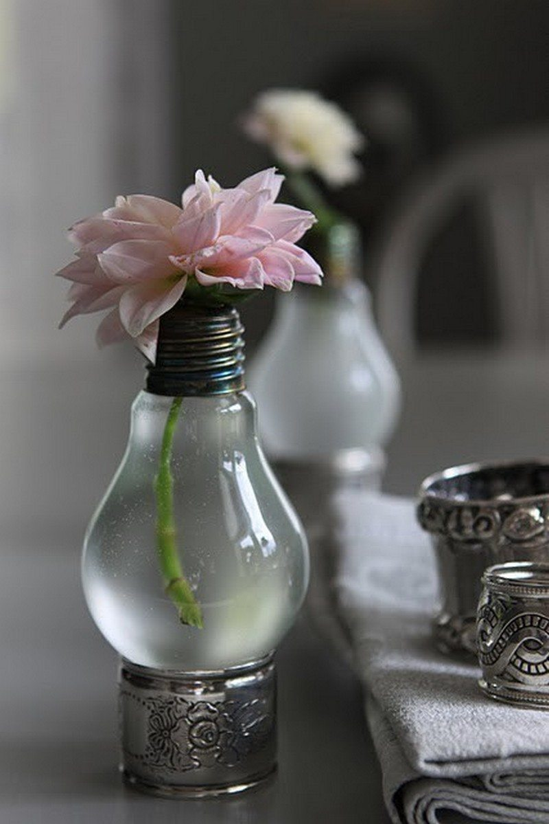 A light bulb vase sitting on a napkin ring