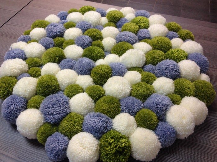make your own pompom rug craft projects for every fan. Black Bedroom Furniture Sets. Home Design Ideas