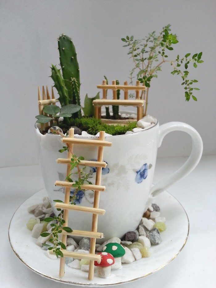 how to make a fairy garden with teacups craft projects for every fan. Black Bedroom Furniture Sets. Home Design Ideas