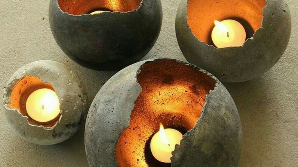 These concrete candle holders are very easy to make.