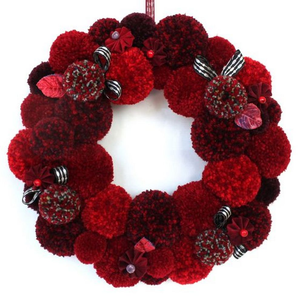 These yarn pom pom wreaths are very easy you'd have a fun time making them!