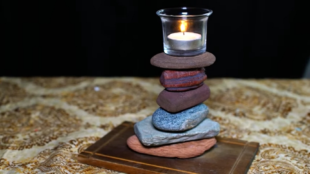 This rock candle holder is an inexpensive project that'll give you a unique statement piece.